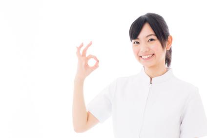 attractive asian nurse on white background