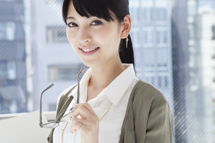 Beautiful Asian women have a pair of glasses